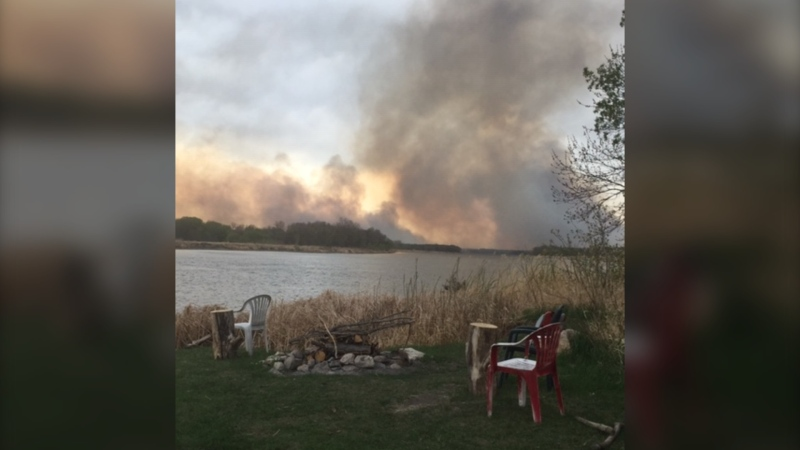 Smoke could be seen across the Red River as crews battled a fire in the Breezy Point area on May 16, 2021. (Source: Margaret Young)