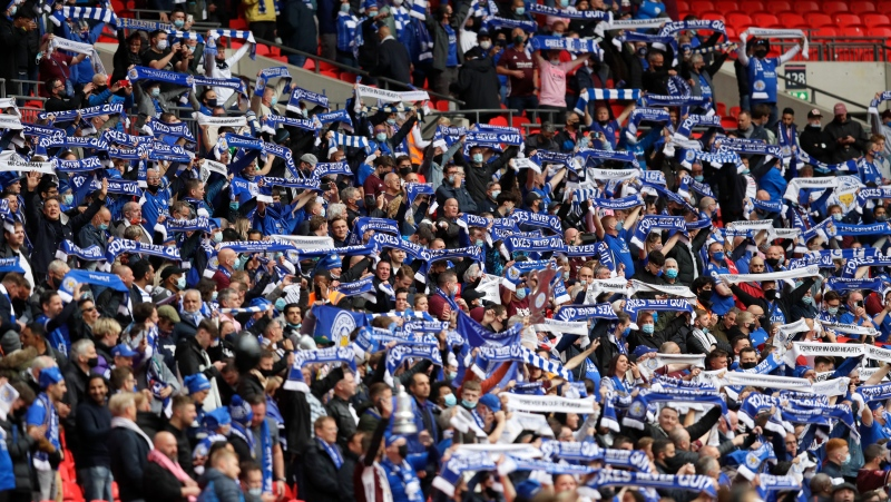 Leicester City fans hold up their scarves before the FA Cup final soccer match between Chelsea and Leicester City at Wembley Stadium in London, England, Saturday May 15, 2021. (AP Photo/Kirsty Wigglesworth, Pool)