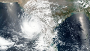 This Sunday, May 16, 2021, satellite image released NASA shows a cyclone approaching western India. A severe cyclone is roaring in the Arabian Sea off southwestern India with winds of up to 140 kmh (87 mph), already causing heavy rains and flooding that have killed multiple people, officials said Sunday. (NASA Worldview, Earth Observing System Data and Information System (EOSDIS) via AP)