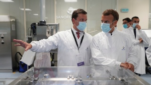 In this June 16, 2020, file photo, French President Emmanuel Macron listens to researchers as he visits an industrial development laboratory at French drugmaker's vaccine unit Sanofi Pasteur plant in Marcy-l'Etoile, near Lyon, central France, Tuesday. (AP Photo/Laurent Cipriani, Pool, File)