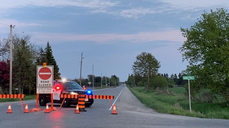 An OPP officer blocks Nissouri Road at Evelyn Drive on Sunday, May 16, 2021. (Reta Ismail / CTV London)