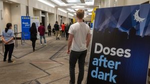 Hundreds of people line up for their COVID-19 vaccine at the Peel Region Doses After Dark vaccination clinic in Mississauga, Ont. on Saturday, May 15, 2021. THE CANADIAN PRESS/Frank Gunn