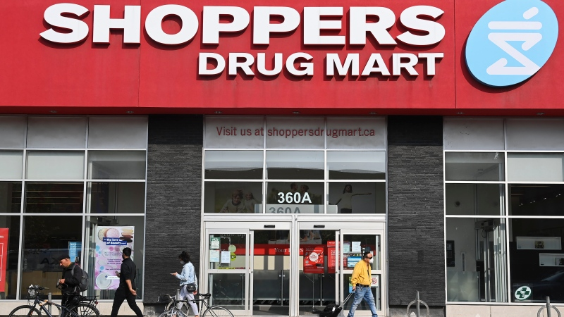 People leave a Shoppers Drug Mart where they are providing COVID-19 testing by appointment only during the COVID-19 pandemic in Toronto on Friday, September 25, 2020. THE CANADIAN PRESS/Nathan Denette