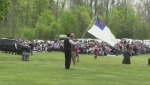 Hundreds gather for an outdoor service with the Church of God in Aylmer, Ont. on Sunday, May 16, 2021.