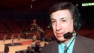 Marv Albert poses at Madison Square Garden in New York, in this Sunday, Feb. 7, 1999, file photo, where he broadcast the Knicks season home opener against the Miami Heat for WFAN radio. Marv Albert plans to retire following the NBA's Eastern Conference finals, ending a broadcasting career that has spanned nearly 60 years. (AP Photo/Ron Frehm, File)
