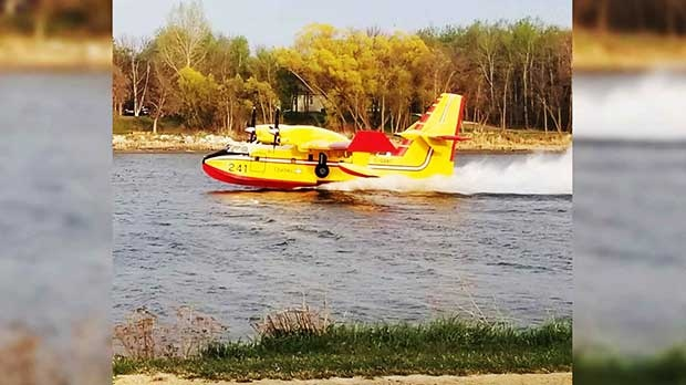 The water bombers working on the Red River. Photo by Karen Fey.