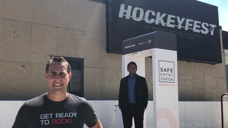 Jones Entertainment President Brad Jones and Dr. Rahul Kushwah, COO of Predictmedix Inc. are seen with a Safe Entry Station in London, Ont. on Monday, May 17, 2021. (Jordyn Read / CTV News)