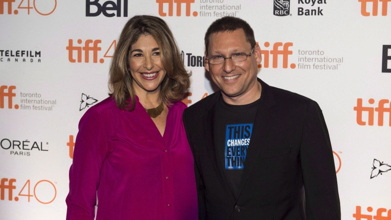 Director Avi Lewis, right, and author Naomi Klein of the film 'This Changes Everything,' stand for a photo on the red carpet during the Toronto International Film Festival press conference announcing the 2015 Canadian features and shorts lineup in Toronto on Wednesday, August 5, 2015. THE CANADIAN PRESS/Aaron Vincent Elkaim