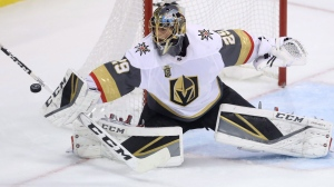 Vegas Golden Knights goaltender Marc-Andre Fleury (29) deflects the puck wide of the net during first period NHL hockey action against the Winnipeg Jets' during Western Conference Finals, game 5, in Winnipeg, Sunday, May 20, 2018. THE CANADIAN PRESS/Trevor Hagan