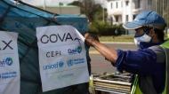 Airport workers spray the cargo of COVAX COVID-19 vaccines on arrival in Antananarivo, Madagascar, Saturday May 8, 2021. (AP Photo/Alexander Joe)