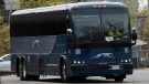 A Greyhound bus is driven out of the bus terminal in Ottawa, on May 7, 2020. (Adrian Wyld / THE CANADIAN PRESS)