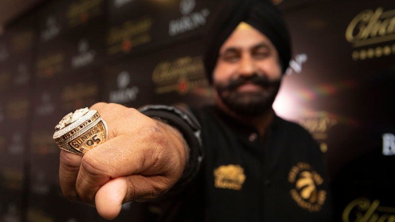 Toronto Raptors 'Superfan' Nav Bhatia shows off the detail on a championship ring presented to him following a ceremony to celebrate the Raptors' 2019 NBA Championship ahead of their home opener against New Orleans Pelicans in Toronto on Tuesday October 22, 2019. THE CANADIAN PRESS/Chris Young