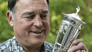 Frank Mahovlich looks at a replica of the Prince of Wales trophy in Toronto on Tuesday, Oct. 4, 2005. (CP PHOTO/Adrian Wyld)