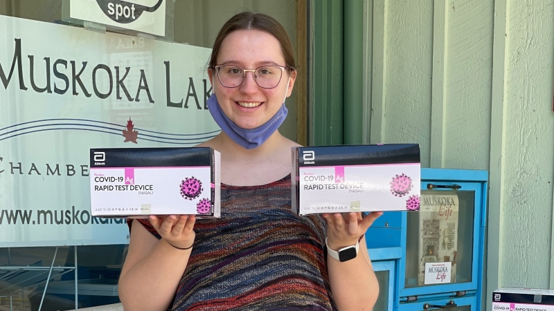 Summer Student Britney Hammell of the Muskoka Lakes Chamber of Commerce with Abbot's rapid screening tests (Courtesy of Muskoka Lakes Chamber of Commerce)