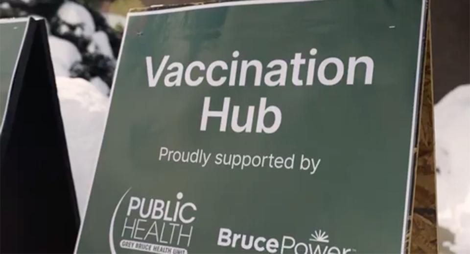 Hockey hub vaccination site sign
