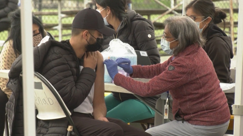 People get vaccinated at a drop-in clinic in Surrey on May 17, 2021.