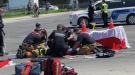 Emergency crews treat a pedestrian who was seriously injured after being struck by a truck near the intersection of Honore-Beauregard Street and Souligny Avenue Monday, May 17, 2021. (Submitted photo)