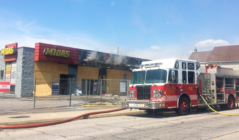 For the second time in recent months, the Midas building in North Bay is on fire. (Eric Taschner/CTV News)