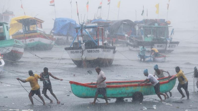 Fishermen try to move a fishing boat to a safer ground on the Arabian Sea coast in Mumbai, India, Monday, May 17, 2021. (AP Photo / Rafiq Maqbool)