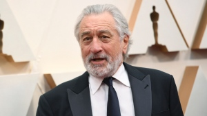 "FILE - Robert De Niro appears at the Oscars in Los Angeles on Feb. 9, 2020. A leg injury may keep De Niro from celebrating the 20th Anniversary of the Tribeca Film Festival in person. The accident happened last week in Oklahoma while on location for the upcoming Martin Scorsese film, ""Killers of the Flower Moon."" (Photo by Richard Shotwell/Invision/AP, File)"