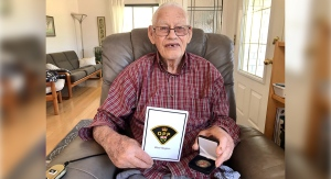 Ed Butler of Lucan, Ont. holds the Regional Commanders Coin given to him in honour of his late grandfather Peter Butler III, who was the first Black officer to serve with the Ontario Provincal Police. (Sean Irvine / CTV News)