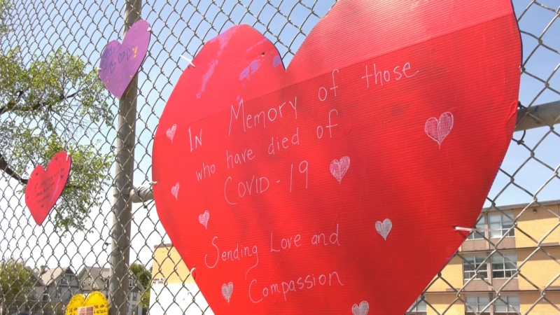 A heart is displayed on the fence at Gordon Bell High School to pay tribute to Manitobans who have died from COVID-19. (CTV News Photo Glenn Pismenny)