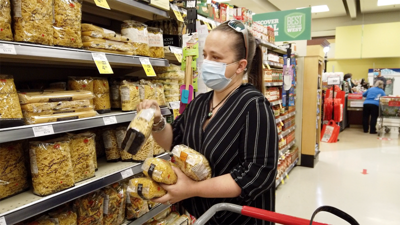 Jennifer Rapuano-Kremenik buying food for the hampers she creates at Harvest Hills Cares