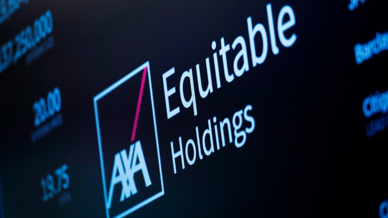 An electronic screen displays a listing for AXA Equitable Holdings, Thursday, May 10, 2018, in New York.  (AP Photo/Mark Lennihan)