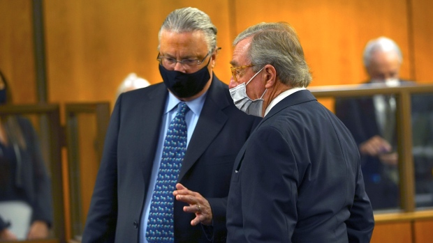 Defense attorneys David Z. Chesnoff, left, and Dick DeGuerin talk to each other during the murder trial of Robert Durst Monday, May 17, 2021, in Inglewood, Calif. (Al Seib/Los Angeles Times via AP, Pool)
