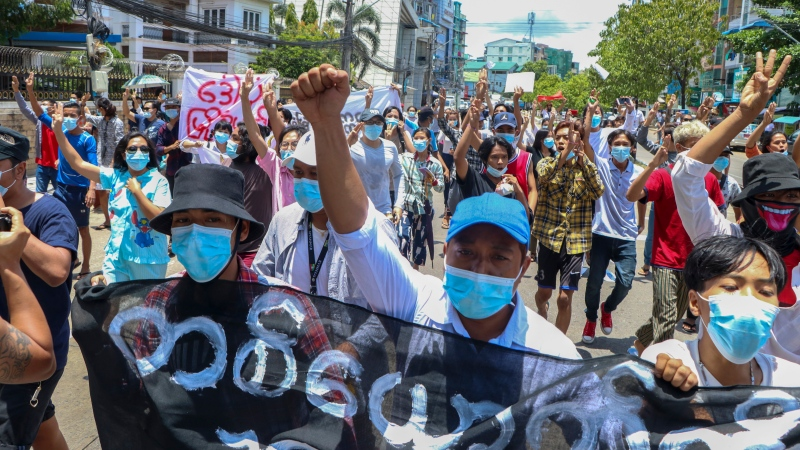 Anti-coup protesters march during a demonstration in Yangon, Myanmar on Wednesday May 12, 2021. (AP Photo)
