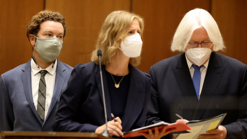 Actor Danny Masterson, left, stands with his lawyers Thomas Mesereau, right, and Sharon Appelbaum during his arraignment in Los Angeles Superior Court in Los Angeles, Friday, Sept. 18, 2020. (Lucy Nicholson/Pool Photo via AP)