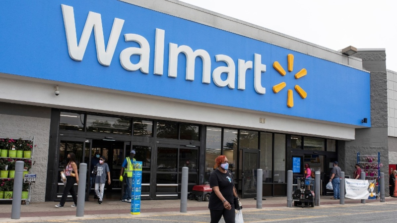 Shoppers walk out of a Walmart store in Waldorf, Md., on May 7, 2021. (Brittany N. Gaddy / University of Maryland via AP)