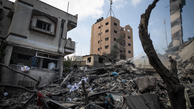 The remains of a six-story building destroyed by an early morning Israeli airstrike are seen in Gaza City, Tuesday, May 18, 2021. (AP Photo/Khalil Hamra)