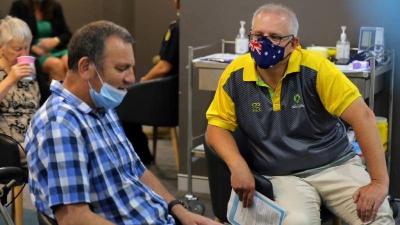 Australian Prime Minister Scott Morrison (right) has defended his pandemic border policy.