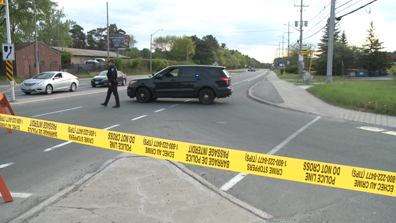 Police closed a section of Hunt Club Road after two men were shot on the morning of Tuesday, May 18, 2021. (Jim O'Grady/CTV News Ottawa)