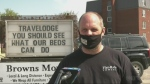 Flat Rate Towing in North Bay takes aim at the local Travelodge in sign war. May 17/21 (Eric Taschner/CTV Northern Ontario)