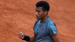 Felix Auger-Aliassime of Canada celebrates after beating Diego Schwartzman of Argentina at the Italian Open tennis tournament, in Rome, Tuesday, May 11, 2021. Auger-Aliassime beat Diego Schwartzman 6-1, 6-3. (AP Photo/Alessandra Tarantino)