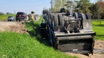 Emergency crews on the scene of a dump truck rollover in Mono, Ont. on Tues, May 18, 2021 (OPP/Twitter)