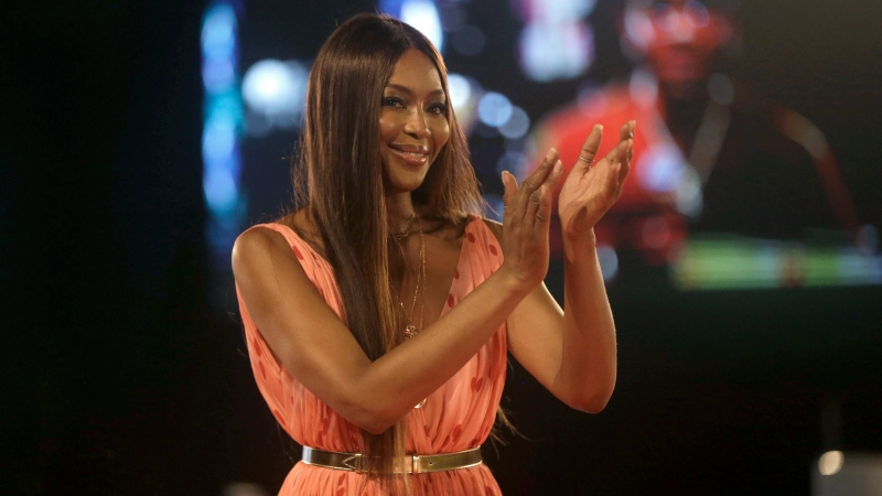 In this Sunday, Dec. 13, 2020 file photo, British model Naomi Campbell attends ARISE Fashion Week event in Lagos, Nigeria. Naomi Campbell says she has become mother to a baby girl. The 50-year-old supermodel announced the news Tuesday, May 18, 2021 on Instagram, posting a picture of her hand holding a baby's feet. (AP Photo/Sunday Alamba, file)
