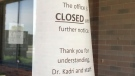 Signs on the door of Kadri's Kidney Care clinic indicate the office is currently closed indefinitely. (Michelle Maluske)