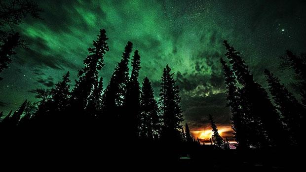Amazing northern lights in Knee Lake. Photo by Wayne Boychuk.