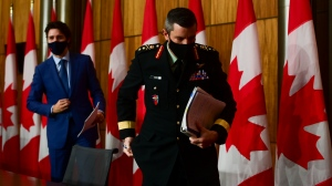 Prime Minister Justin Trudeau and Major-General Dany Fortin leave a press conference in Ottawa on Thursday, Dec. 10, 2020. THE CANADIAN PRESS/Sean Kilpatrick