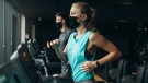 People working out in a gym while wearing masks in an undated image. (Shutterstock)