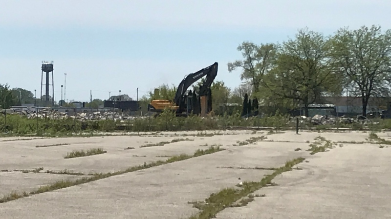 Crews have already started to demolish what's left of the concrete where the former Navistar plant used to sit in Chatham, Ont. on Tuesday, May 18, 2021. (Michelle Maluske/CTV Windsor)
