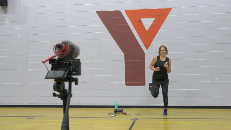 Jenni Stotts of the Brockville, Ont. YMCA making a workout video Tuesday, May 18, 2021. (Nate Vandermeer / CTV News Ottawa)