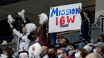 Fans wave a placard for the Colorado Avalanche in the third period of Game 1 of an NHL hockey Stanley Cup first-round playoff series against the St Louis Blues, Monday, May 17, 2021, in Denver. (AP Photo/David Zalubowski)