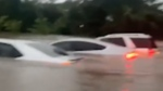 Vehicles submerged by floodwater in Louisiana