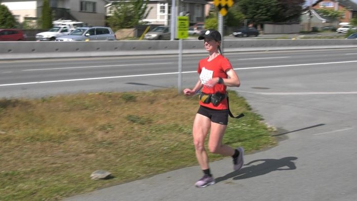 Marathon runner Yana Hempler running in Saanich on May 18,2021. (CTV News)