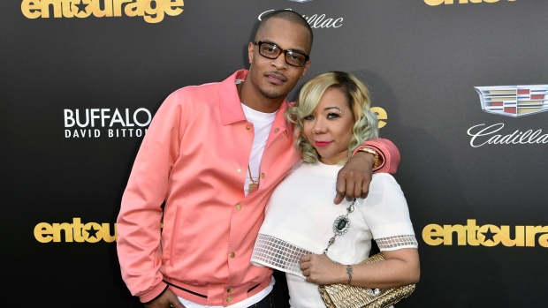 """FILE - In this Monday, June 1, 2015 file photo, T.I., left, and Tiny arrive at the Los Angeles premiere of """"Entourage"""" at the Westwood Regency Village Theatre. Rapper T.I. and his wife Tameka """"Tiny"""" Harris are under investigation by police in Los Angeles after a sexual abuse allegation.(Photo by Rob Latour/Invision/AP, File)"""