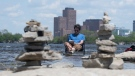 Jason Roy relaxes in the cool waters of the Ottawa River Tuesday, May 18, 2021 in Ottawa. Temperatures are expected to reach summer conditions with 30C forecast for Thursday. (Adrian Wyld/THE CANADIAN PRESS)